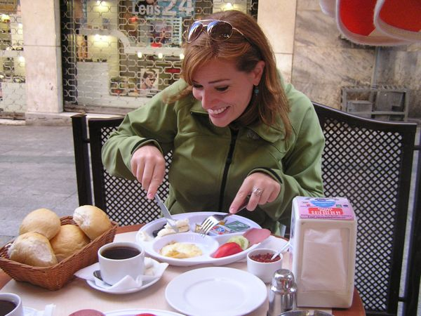 Leslie diving into Turkish breakfast