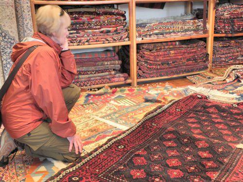 Susan contemplates rug purchase