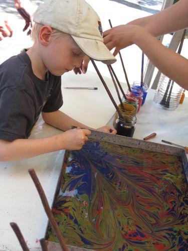 Elijah swirls his colors